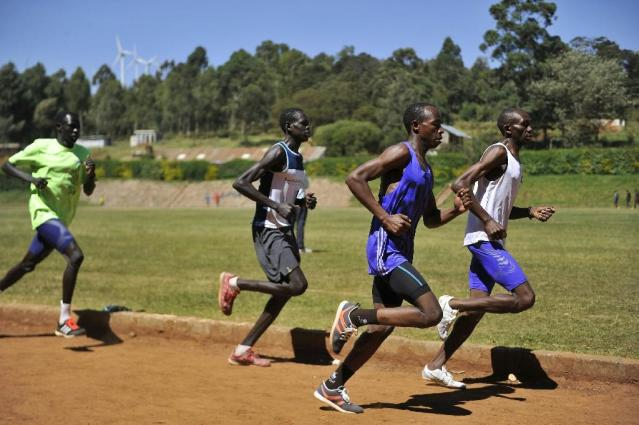South Sudanese refugees from the Kakuma refugee camp train at Kenya's rugged Ngong hills (AFP Photo/Simon Maina)