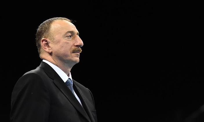 Azerbaijan's President Ilham Aliyev looks on as he hosts the medal ceremony for the men's light heavy weight (+81kg) boxing event at the 2015 European Games in Baku June 25, 2015. AFP PHOTO / TOBIAS SCHWARZ (AFP Photo/Tobias Schwarz)