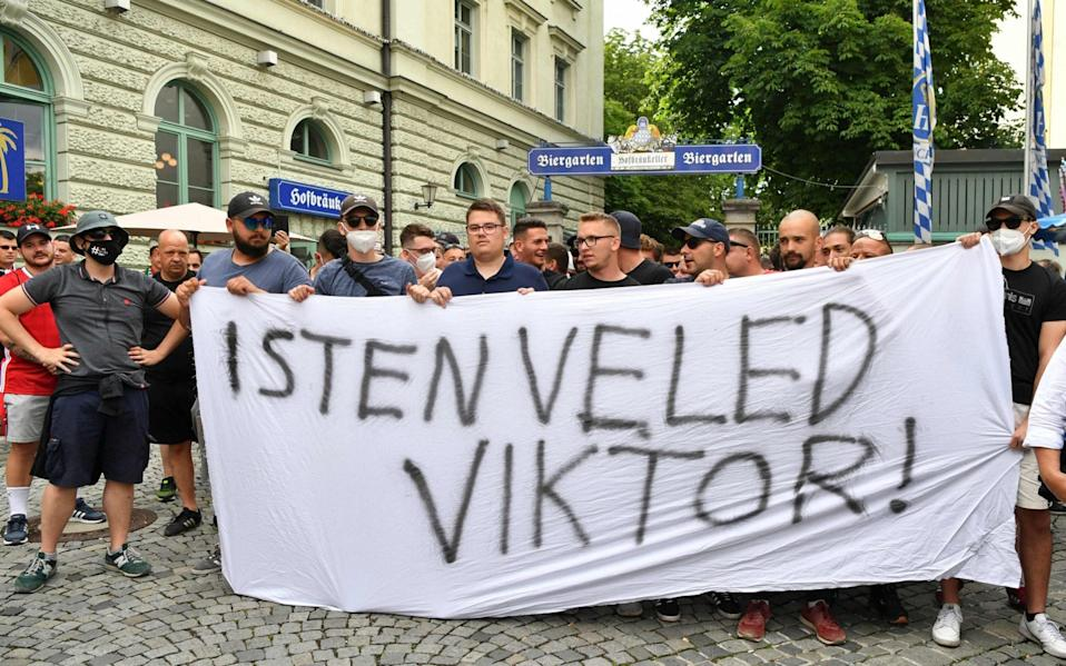 """Hungary's supporters are seen at Wienerplatz as they hold a banner reading """"God is with you Viktor"""", - AFP"""