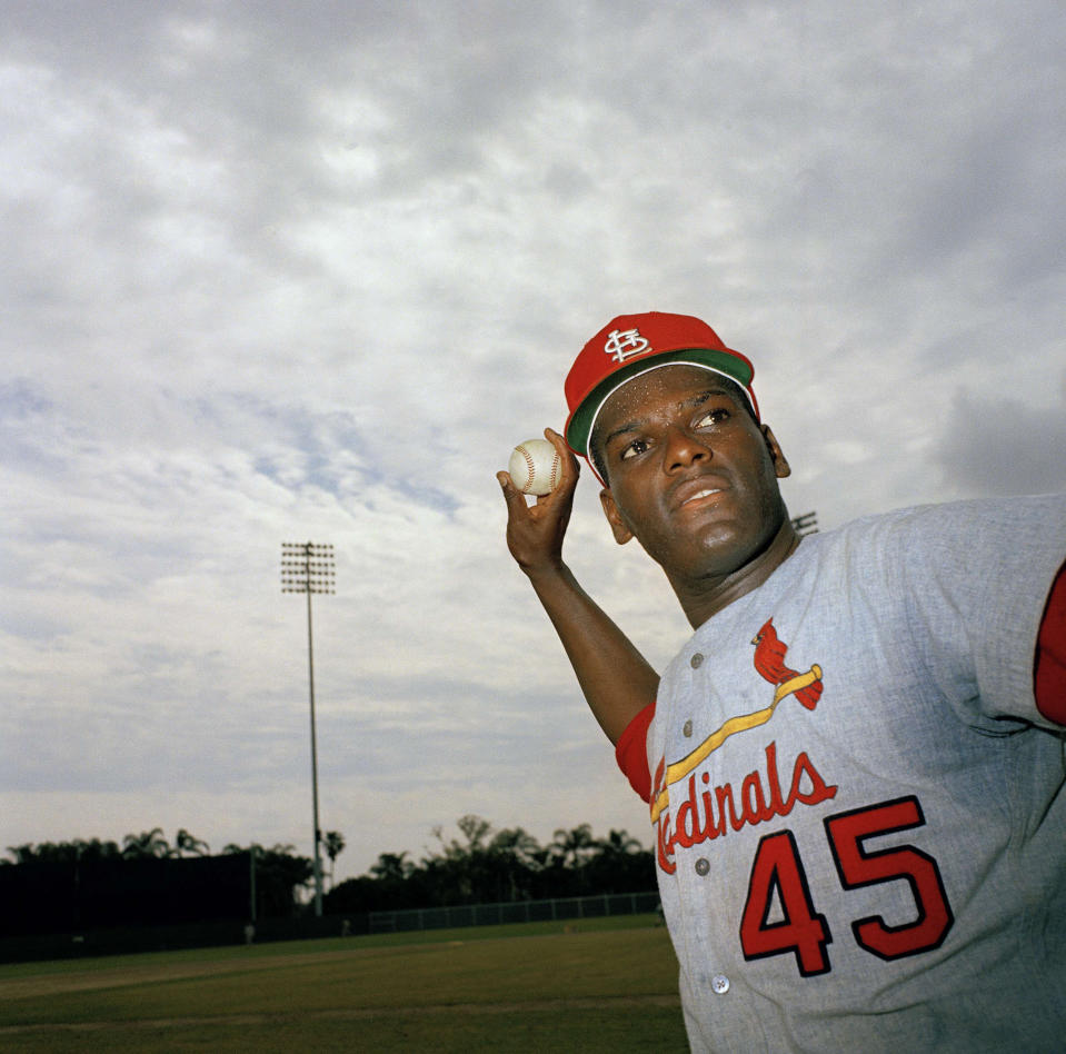 """One of the most feared pitchers of his era, Gibson spent his entire 17-year career with the Cardinals, bringing two World Series to St. Louis. A fierce competitor who famously hated the All-Star Game, Gibson won two Cy Young awards and a National League MVP during his Hall of Fame career. He was the MVP of the two World Series the Cardinals won and finished his career with 251 wins, 3,117 strikeouts and a 2.91 ERA. His dominant 1968 season – 22 wins, 13 shutouts and a 1.12 ERA – led to MLB lowering the pitcher's mound from 15 to 10 inches. """"I was pissed,"""" he famously said of the move. Gibson, who revealed he had pancreatic cancer in 2019, was 84."""