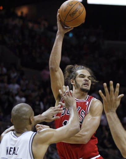 Chicago Bulls' Joakim Noah, right, looks to pass the ball away from San Antonio Spurs' Gary Neal during the second half of an NBA basketball game, Wednesday, Feb. 29, 2012, in San Antonio. Chicago won 96-89. (AP Photo/Darren Abate)