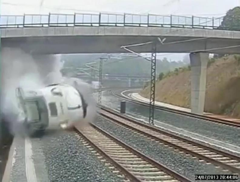 This image taken from security camera video shows a train derailing in Santiago de Compostela, Spain, on Wednesday, July 24, 2013. Spanish investigators tried to determine Thursday why a passenger train jumped the tracks and sent eight cars crashing into each other just before arriving in this northwestern shrine city on the eve of a major Christian religious festival, killing at least 77 people and injuring more than 140. (AP Photo)
