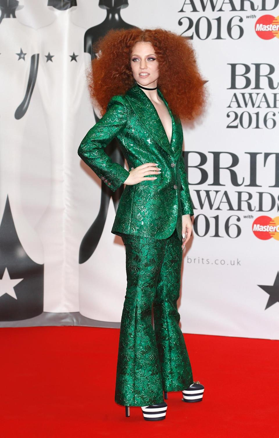 <p>We're not sure whether we love or hate Jess' emerald green trouser suit and platform heels combo… Thoughts? <i>[Photo: Getty]</i></p>
