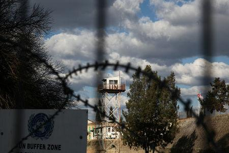 An abandoned UN outpost is seen behind the barbed wire inside the UN-controlled buffer zone in Nicosia, Cyprus February 16, 2017. REUTERS/Yiannis Kourtoglou