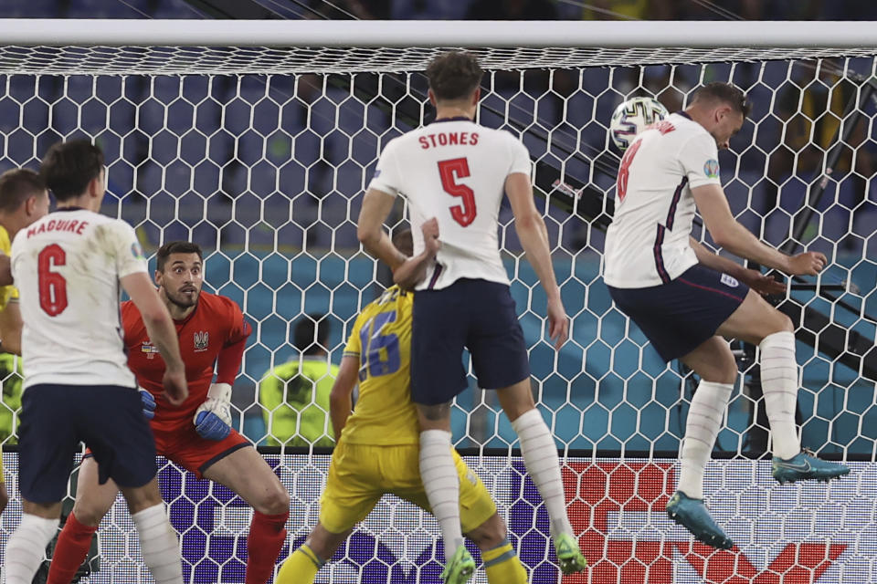 England's Jordan Henderson, right, scores his side's fourth goal during the Euro 2020 soccer championship quarterfinal soccer match between Ukraine and England at the Olympic stadium, in Rome, Italy, Saturday, July 3, 2021. (Lars Baron/Pool Photo via AP)
