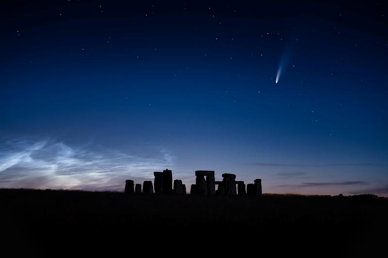 """A blazing comet that has travelled for 6,800 years was seen streaking over Stonehenge on a perfect summer's evening. See SWNS story SWBRcomet; Photographer Matthew Brown, 37, drove nearly three hours away from his home to get to the iconic neolithic stone monument to capture it during the """"clearest sky of the year"""". On a spectacular evening, the rare Neowise comet could be seen as it came as close as 103 million km away from earth. The photographer managed to capture the breathtaking shot of the comet flying over the rocks late Friday night (July 10). The fireball shot through the sky on its once-in-a-6,800-year journey with the stunning Noctilucent clouds behind it. Noctilucent clouds, or night shining clouds, are A cloud-like phenomena in the upper atmosphere of Earth."""