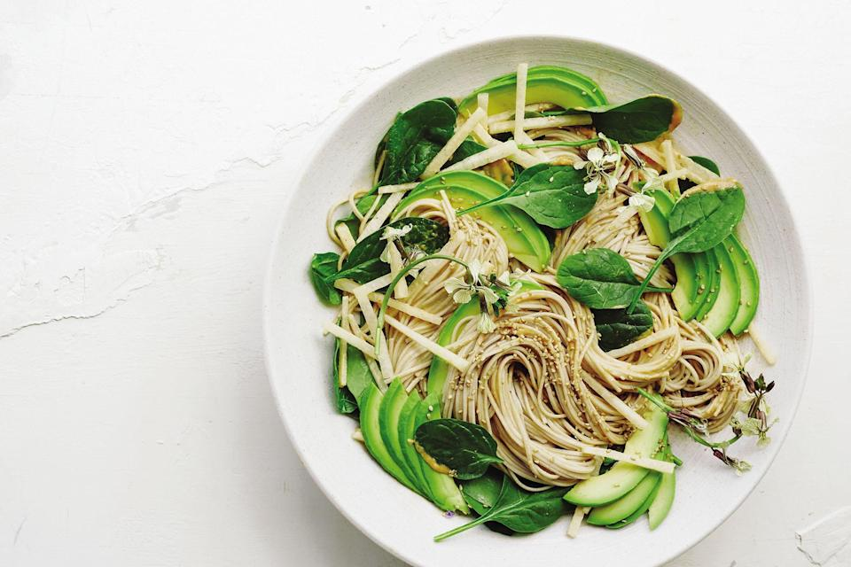 """Soba + tahini + avocado? Enough said. This full-meal noodle salad has crunchy jicama, too, and lots of baby spinach, plus a bit of miso for savory flavor. <a href=""""https://www.epicurious.com/recipes/food/views/spicy-tahini-and-avocado-soba?mbid=synd_yahoo_rss"""" rel=""""nofollow noopener"""" target=""""_blank"""" data-ylk=""""slk:See recipe."""" class=""""link rapid-noclick-resp"""">See recipe.</a>"""