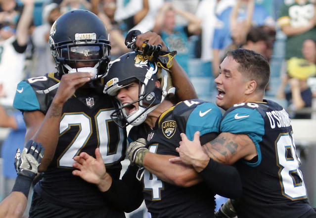 <p>Jacksonville Jaguars kicker Josh Lambo, center, celebrates his game winning 30-yard field goal against the Los Angeles Chargers with teammates cornerback Jalen Ramsey (20) and tight end James O'Shaughnessy, right, during the second half of an NFL football game, Sunday, Nov. 12, 2017, in Jacksonville, Fla. Jacksonville won 20-17 in overtime. (AP Photo/Stephen B. Morton) </p>