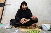Ghatwa al-Mohommad, 80, says she is scared of coronavirus and confused about what to do -- but at the same time, afraid of leaving the camp