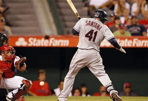 Cleveland Indians' Carlos Santana is hit by a pitch from the Los Angeles Angels' Zack Greinke as catcher Chris Iannetta watches, resulting in a warning to the pitcher and both benches, in the fourth inning of a baseball game in Anaheim, Calif., Tuesday, Aug. 14, 2012. (AP Photo/Reed Saxon)