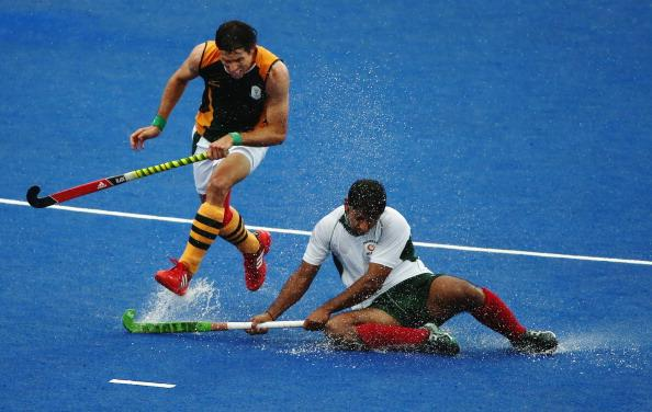 LONDON, ENGLAND - AUGUST 05:  Thornton McDade of South Africa and Muhammad Imran of Pakistan challenge for the ball during the Men's Hockey match between Pakistan and South Africa on Day 9 of the London 2012 Olympic Games at Riverbank Arena Hockey Centre on August 5, 2012 in London, England.  (Photo by Daniel Berehulak/Getty Images)
