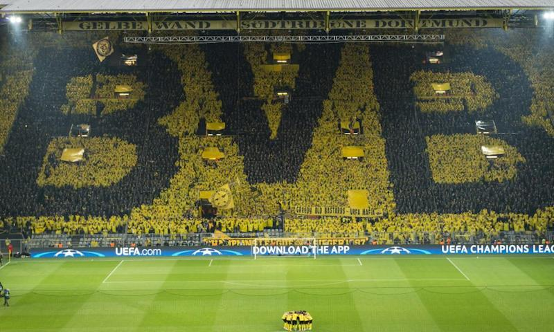 Borussia Dortmund fans wore ponchos to create the club's BVB crest – Ballsportverein Borussia - in giant letters.