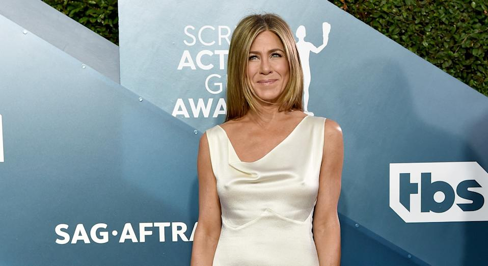 Jennifer Aniston has revealed the hilarious way she avoided getting creases in her dress on the way to the SAG Awards [Image: Getty]