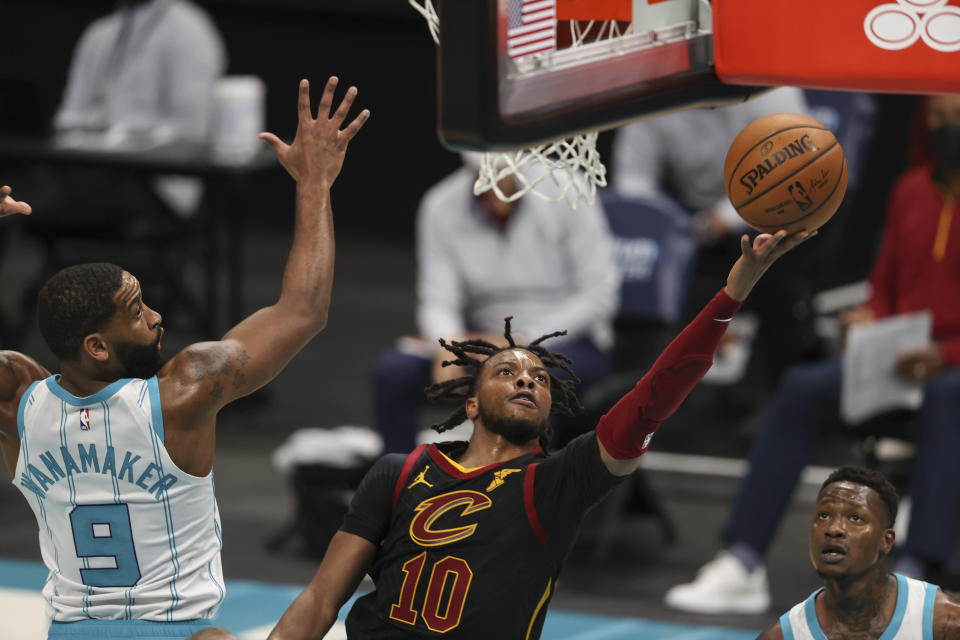 Cleveland Cavaliers guard Darius Garland (10) drives to the basket past Charlotte Hornets guard Brad Wanamaker (9) during the second quarter of an NBA basketball game in Charlotte, N.C., Wednesday, April 14, 2021. (AP Photo/Nell Redmond)
