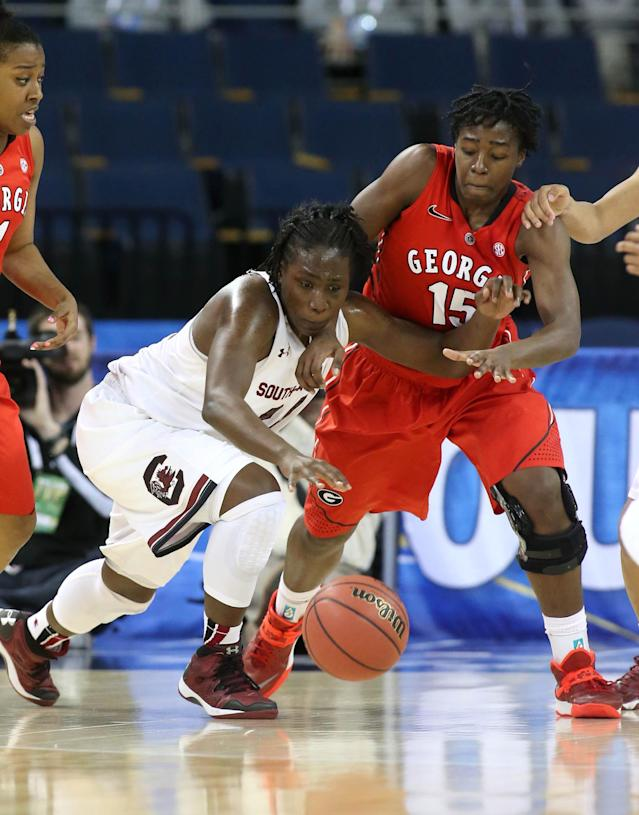 South Carolina forward Aleighsa Welch (24) steals the ball away from Georgia guard Krista Donald (15) in the first half of the third round of the women's Southeastern Conference NCAA college basketball game, Friday, March 7, 2014, in Duluth, Ga. (AP Photo/Jason Getz)