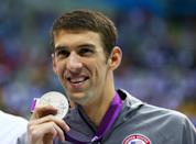 <b>Medal No. 18</b><br>Silver medalist Michael Phelps poses with his medal during the medal ceremony for the Men's 200m Butterfly at the 2012 Olympics in London.