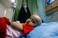 A child who suffers from cancer lies on a bed at the Children's Hospital for Cancer Diseases in Basra