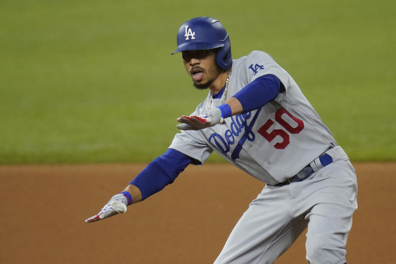 Los Angeles Dodgers' Mookie Betts (50) celebrates a double in Game 3 of a baseball National League Division Series against the San Diego Padres Thursday, Oct. 8, 2020, in Arlington, Texas. (AP Photo/Sue Ogrocki)