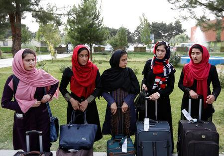 Afghan girls fly to U.S.  for robotics fair