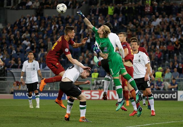 Soccer Football - Champions League Semi Final Second Leg - AS Roma v Liverpool - Stadio Olimpico, Rome, Italy - May 2, 2018 Liverpool's Loris Karius punches clear of Roma's Patrik Schick REUTERS/Max Rossi