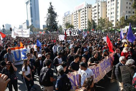 Demonstrators take part in a protest demanding an end to profiteering in the education system in Santiago.