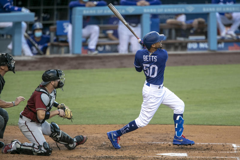 Los Angeles, CA, Monday, July 20, 2020 - Mookie Betts homers in the second inning against Diamondbacks pitcher Taylor Clarke at Dodger Stadium. (Robert Gauthier / Los Angeles Times via Getty Images)