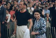 <p>Prince Philip, an avid sportsman and captain of the Windsor Park Team, poses with the Windsor Cup after his team beat India during the Ascot Week Polo Tournament, of which he was the sponsor. The cup was presented by Queen Elizabeth II.</p>