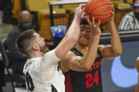 Houston guard Quentin Grimes, right, goes up for a shot against Central Florida forward Sean Mobley, left, during the second half of an NCAA college basketball game, Saturday, Dec. 26, 2020, in Orlando, Fla. (AP Photo/John Raoux)