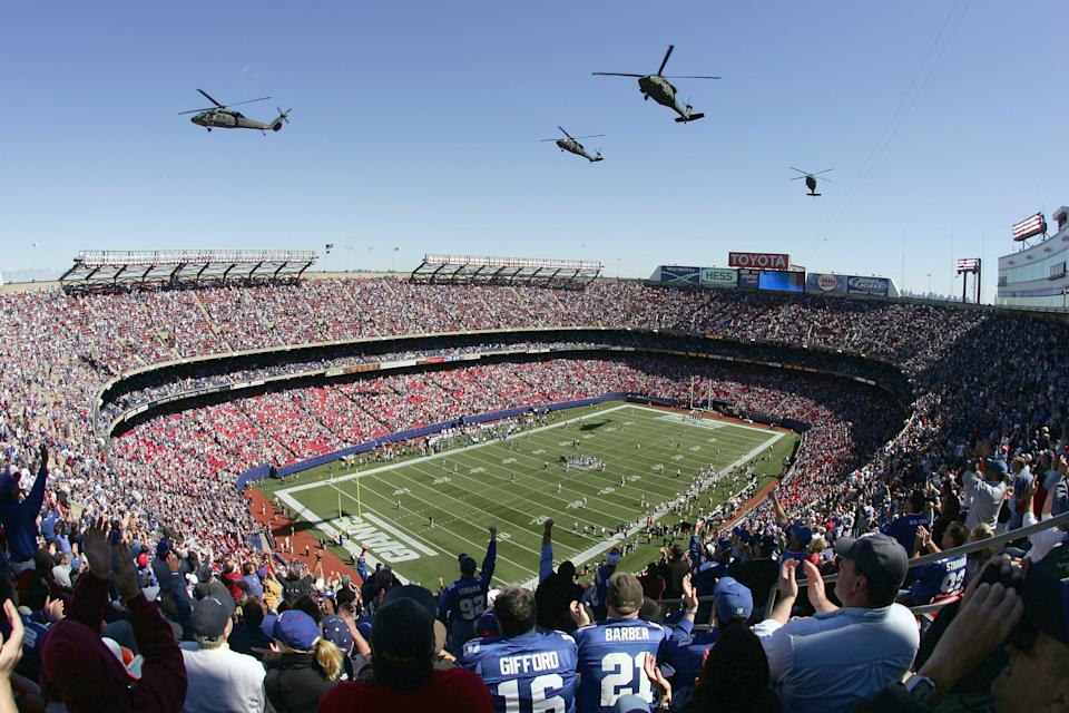 Helicopters fly over Giants Stadium in honor of former Arizona Cardinal Pat Tillman who was killed in the war in Iraq before the start of the New York Giants against the Washington Redskins on September 19, 2004 at Giants Stadium in East Rutherford, New Jersey. (Photo by Al Bello/Getty Images)