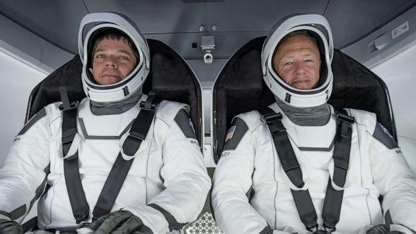 PHOTO: NASA astronauts Bob Behnken, left, and Doug Hurley participate in a fully integrated test of SpaceX Crew Dragon flight hardware at the SpaceX processing facility on Cape Canaveral Air Force Station in Florida, March 30, 2020. (NASA/EPA via Shutterstock, FILE)