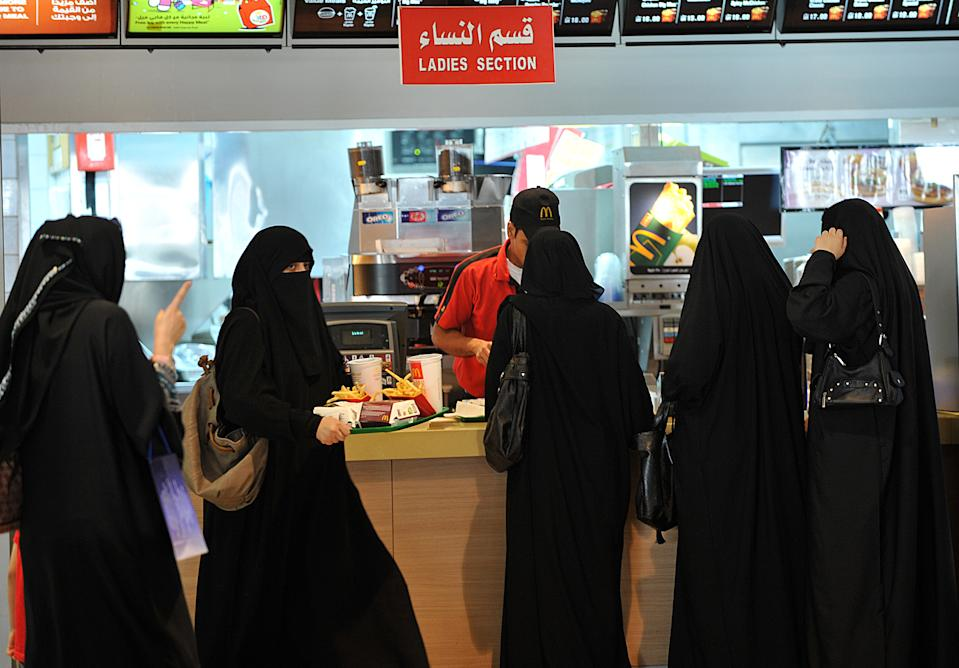 """Saudi women wait in line in the """"women section"""" at of a fast food resturant in the 'Faysalia' mall in Riyadh City, on September 26, 2011, a day after Saudi Arabia's King Abdullah bin Abdulaziz al-Saud granted women the right to vote and run in municipal elections, in a historic first for the ultra-conservative country where women are subjected to many restrictions.AFP PHOTO/FAYEZ NURELDINE (Photo credit should read FAYEZ NURELDINE/AFP via Getty Images)"""