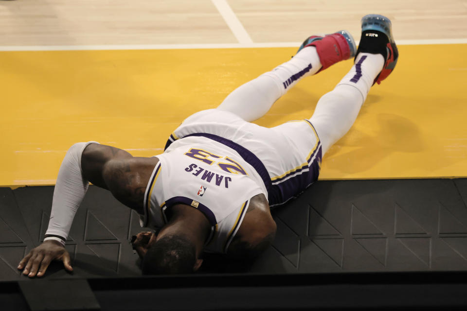 LeBron James #23 of the Los Angeles Lakers reacts to an apparent injury during the second period of a game against the Atlanta Hawks at Staples Center on March 20, 2021 in Los Angeles, California. NOTE TO USER: User expressly acknowledges and agrees that, by downloading and or using this photograph, User is consenting to the terms and conditions of the Getty Images License Agreement. (Photo by Michael Owens/Getty Images)