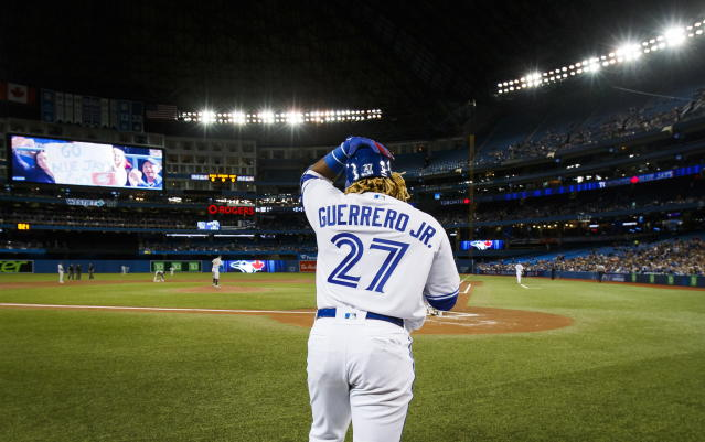 Toronto Blue Jays rookie Vladimir Guerrero Jr. leaves the on-deck circle before his first major league at-bat against the Oakland Athletics during the second inning of baseball game action in Toronto, Friday April 26, 2019. (Mark Blinch/The Canadian Press via AP)