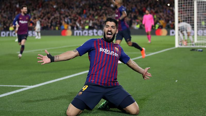 Luis Suarez completes move to Atletico Madrid on two-year deal