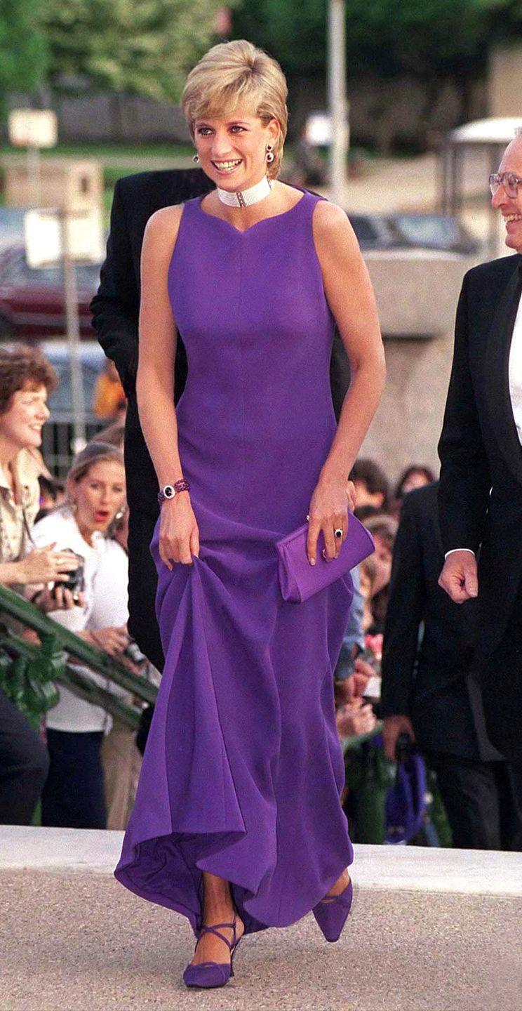 <p>In a purple dress by Versace, matching shoes by Jimmy Choo and a white choker arriving to a dinner at the Museum of Natural History in Chicago. </p>