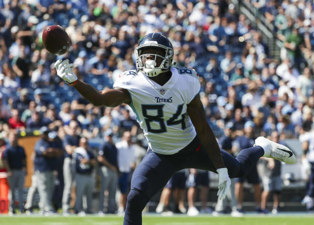<p>Corey Davis #84 of the Tennessee Titans reaches for a pass from Marcus Mariota #8 against the Philadelphia Eagles during the first quarter at Nissan Stadium on September 30, 2018 in Nashville, Tennessee. (Photo by Silas Walker/Getty Images) </p>