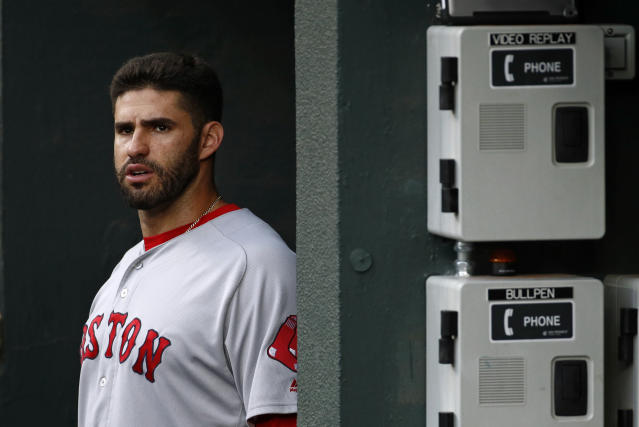 "Instead of talking about the triple crown or the AL East pennant, <a class=""link rapid-noclick-resp"" href=""/mlb/players/9002/"" data-ylk=""slk:J.D. Martinez"">J.D. Martinez</a> found himself answering questions about Hitler and guns on Tuesday. (AP)"