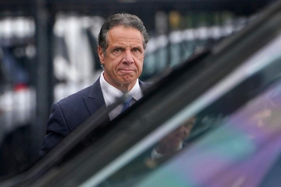 New York Gov. Andrew Cuomo prepares to board a helicopter after announcing his resignation Aug. 10 in New York. Cuomo faces a barrage of sexual harassment allegations.