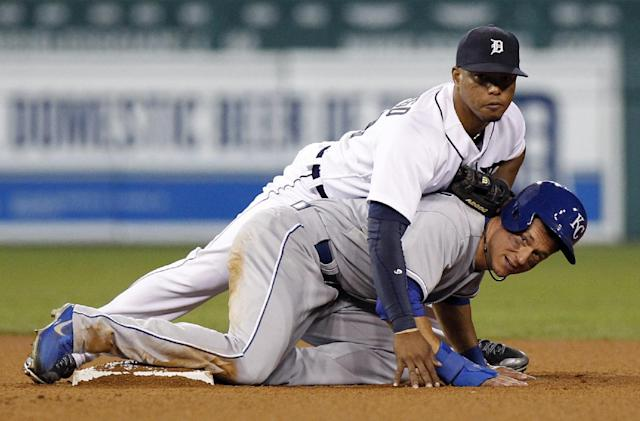Detroit Tigers' Ramon Santiago lands on top of Kansas City Royals' David Lough after getting the force out at second base in the seventh inning during the second game of a doubleheader baseball game Friday, Aug. 16, 2013, in Detroit. Santiago's throw was too late to get Royals' Emilio Bonifacio at first base. (AP Photo/Duane Burleson)
