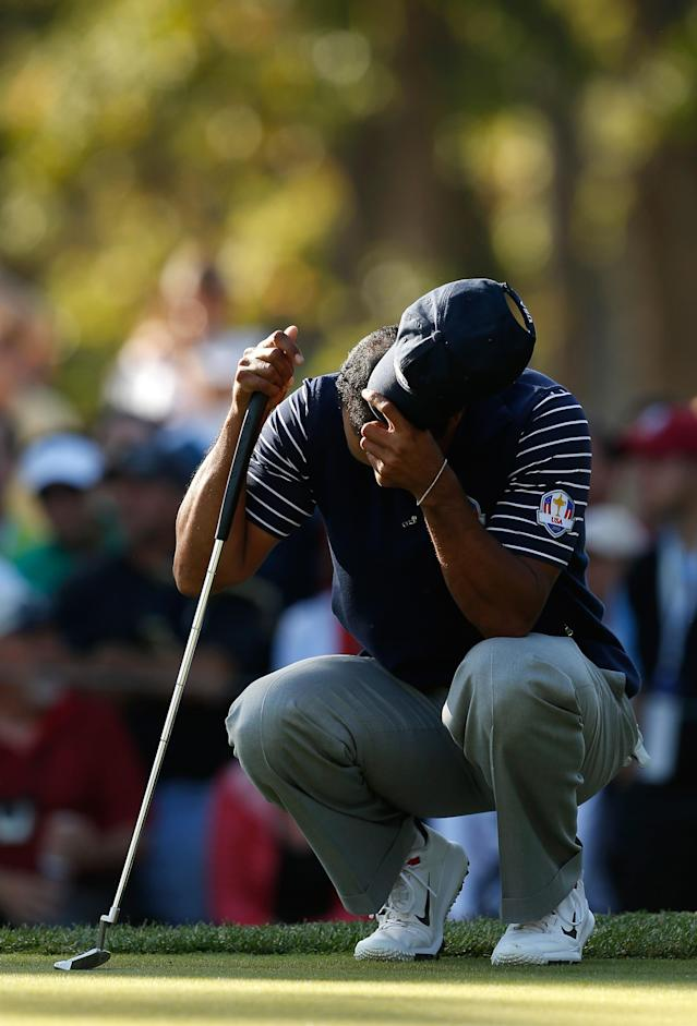MEDINAH, IL - SEPTEMBER 29: Tiger Woods of the USA waits on a green during day two of the Afternoon Four-Ball Matches for The 39th Ryder Cup at Medinah Country Club on September 29, 2012 in Medinah, Illinois. (Photo by Jamie Squire/Getty Images)