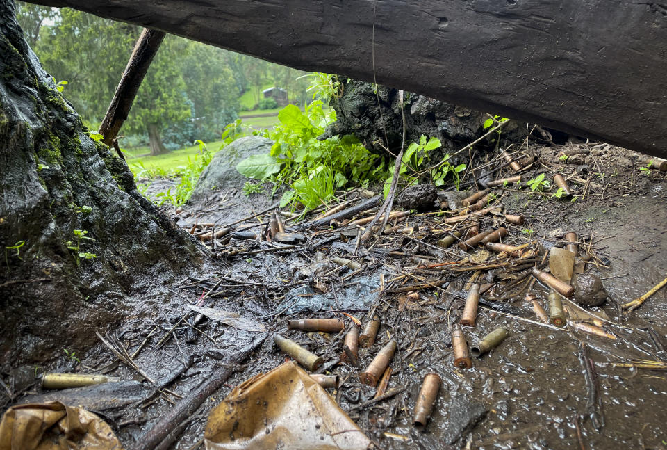 """Spent bullet casings lie scattered on the ground near the village of Chenna Teklehaymanot, in the Amhara region of northern Ethiopia Thursday, Sept. 9, 2021. At the scene of one of the deadliest battles of Ethiopia's 10-month Tigray conflict, witness accounts reflected the blurring line between combatant and civilian after the federal government urged all capable citizens to stop Tigray forces """"once and for all."""" (AP Photo)"""