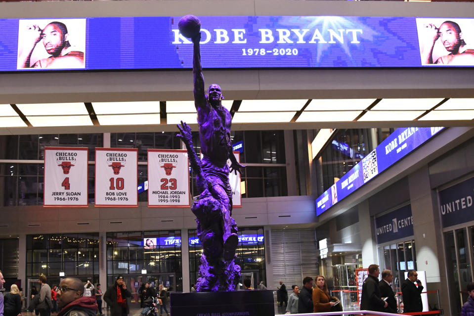 The Michael Jordan statue is illuminated in purple to honor Kobe Bryant before an NBA basketball game between the Chicago Bulls and the San Antonio Spurs Monday, Jan. 27, 2020, in Chicago. (AP Photo/David Banks)