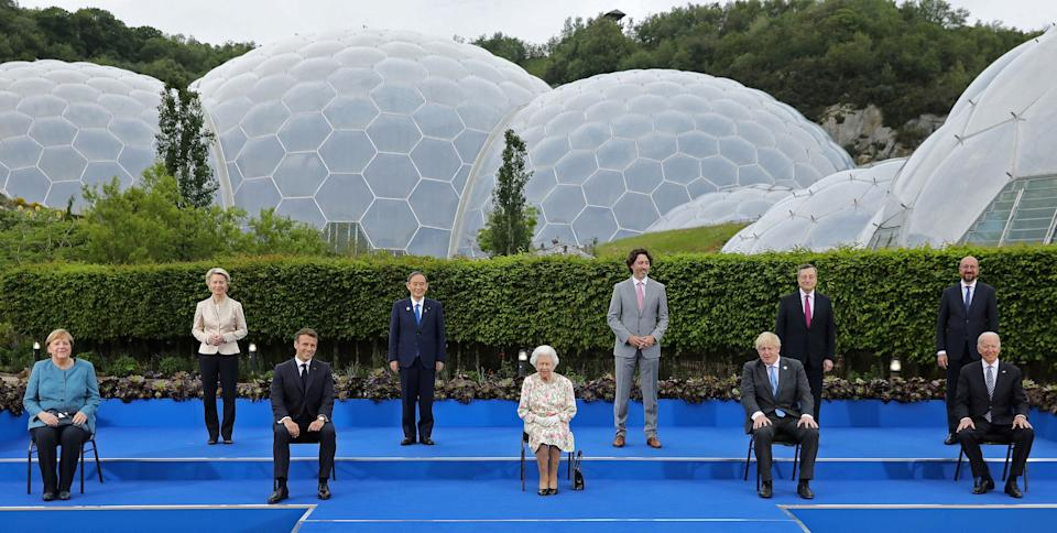Britain's Queen Elizabeth II (C), poses for a family photograph with, from left, Germany's Chancellor Angela Merkel, President of the European Commission Ursula von der Leyen, France's President Emmanuel Macron, Japan's Prime Minister Yoshihide Suga, Canada's Prime Minister Justin Trudeau, Britain's Prime Minister Boris Johnson , Italy's Prime minister Mario Draghi, President of the European Council Charles Michel and US President Joe Biden, during an evening reception at The Eden Project in south west England on June 11, 2021. - G7 leaders from Canada, France, Germany, Italy, Japan, the UK and the United States meet this weekend for the first time in nearly two years, for three-day talks in Carbis Bay, Cornwall. (Photo by JACK HILL / POOL / AFP) (Photo by JACK HILL/POOL/AFP via Getty Images)