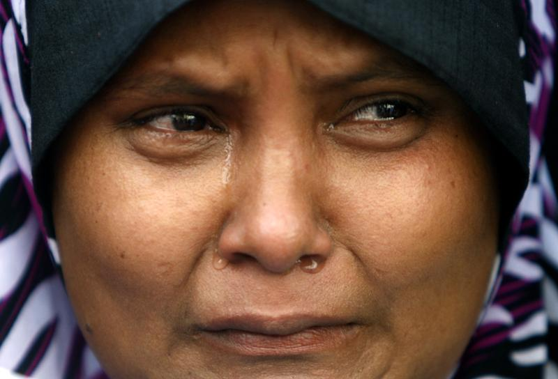 A Rohingya protester cries during a rally to call for an end to the ongoing unrest and violence in Myanmar's Rakhine State, in Kuala Lumpur, Malaysia, Tuesday, June 12, 2012. (AP Photo/Lai Seng Sin)