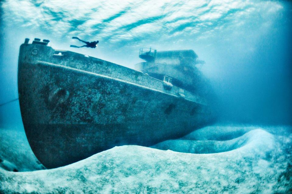 <p>A diver overlooks the USS Kittiwake, a submarine rescue vessel (ASR-13) that was part of the 6th Submarine squadron. The wartime submarine sank off the northern coast of Grand Cayman's Seven Mile Beach.</p>