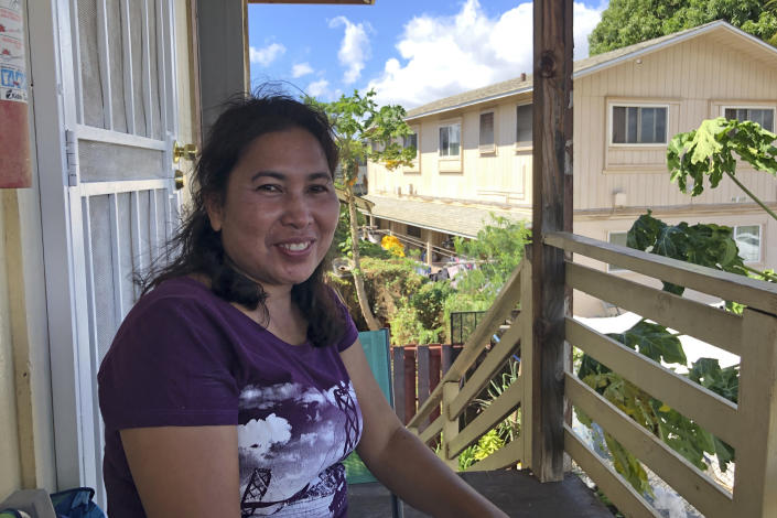 Susan Galicha poses for a photo on her front porch in Waipahu, Hawaii on Oct. 30, 2020.Honolulu is building one of the nation's most expensive rail lines to address some of the nation's worst traffic but tax revenue declines during the pandemic and spiraling costs mean it doesn't currently have enough money to finish the 20-mile route as planned. (AP Photo/Audrey McAvoy)