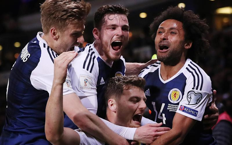 Scotland's players celebrate Chris Martin's late winner against Slovenia  - Getty Images Europe