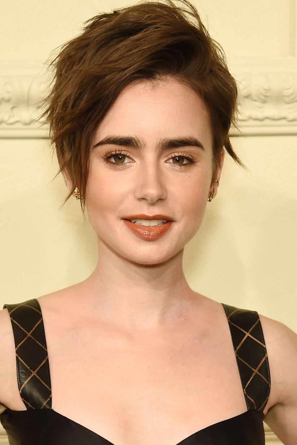 <p>Actress Lily Collins amps up the texturized volume with her layered chop. </p>