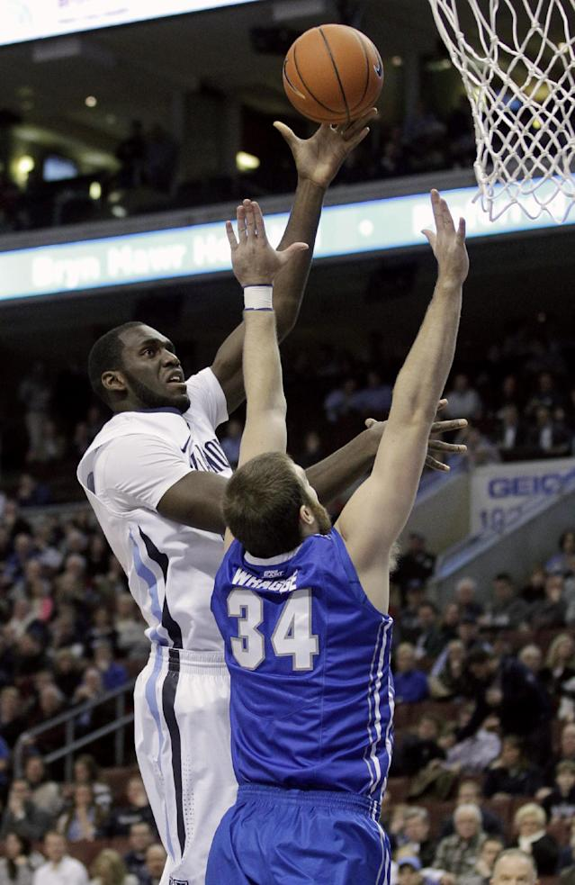 Villanova's Daniel Ochefu, left, takes a shot past Creighton's Ethan Wragge (34) in the first half of an NCAA college basketball game, Monday, Jan. 20, 2014, in Philadelphia. (AP Photo/Laurence Kesterson)