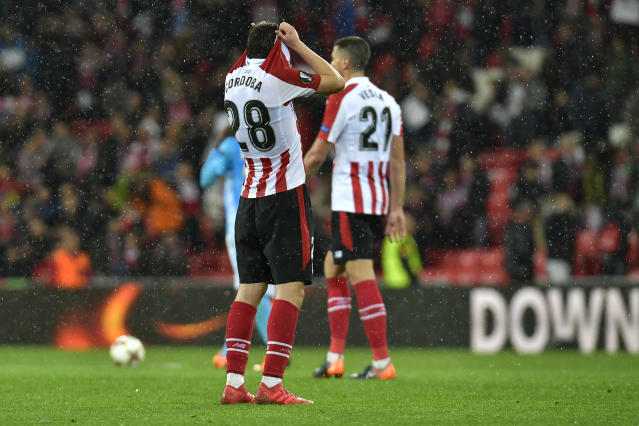 Bilbao's Inigo Cordoba, left, and Mikel Vesga react after their Europa League round of 16, 2nd leg, match between Athletic Bilbao and Olympique Marseille, at San Mames stadium, in Bilbao, northern Spain, Thursday, March 15, 2018. Marseille won 2-1.(AP Photo/Alvaro Barrientos)